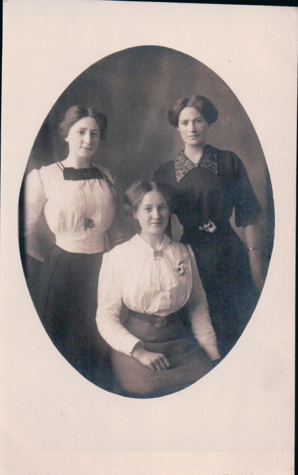 Tragically unlabeled! Is this Anna and her two sisters? Charles' three sisters? Will we ever know?